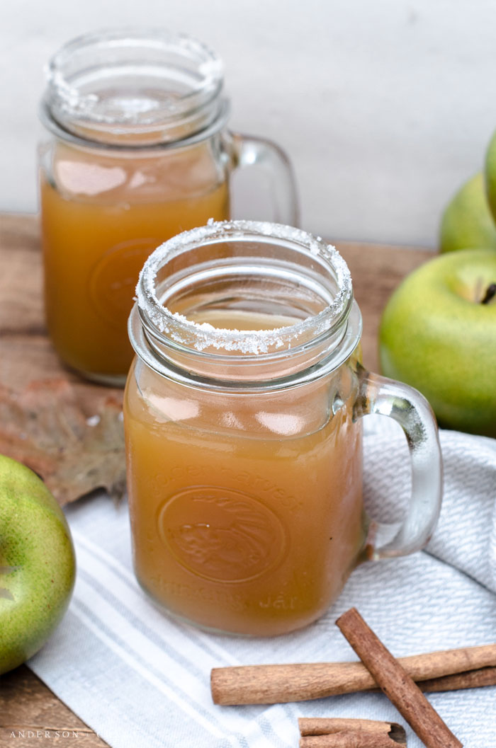 Mug of cider and apples