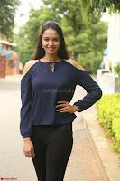 Poojita Super Cute Smile in Blue Top black Trousers at Darsakudu press meet ~ Celebrities Galleries 035.JPG