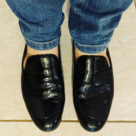 image of my lower legs, clad in jeans, and my feet clad in shiny black flats