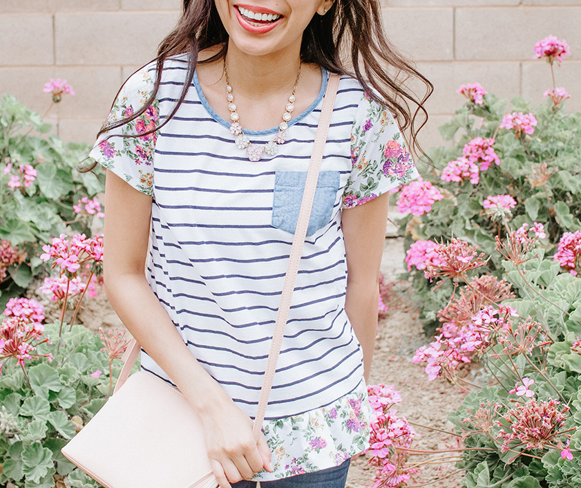 striped t-shirt with floral sleeves in floral background