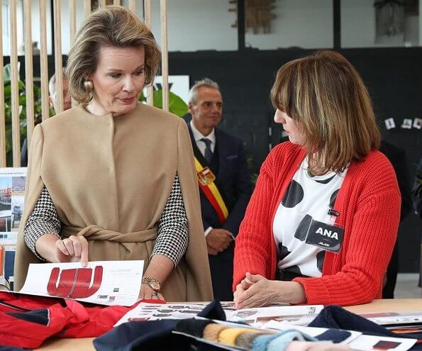 Queen Mathilde visited J and JOY in Waremme which is a clothing brand that is also socially and philanthropically active. Natan dress and camel cape