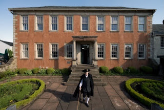 Exterior of Wordsworth House with man in period clothes walking down the path
