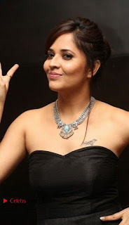 Telugu Anchor Actress Anasuya Bharadwa Stills in Strap Less Black Long Dress at Winner Pre Release Function  0010.jpg