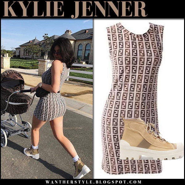 Kylie Jenner in brown vintage fendi logo mini dress and beige ankle boots acne dinila with stormi in fendi stroller spring fashion april 12