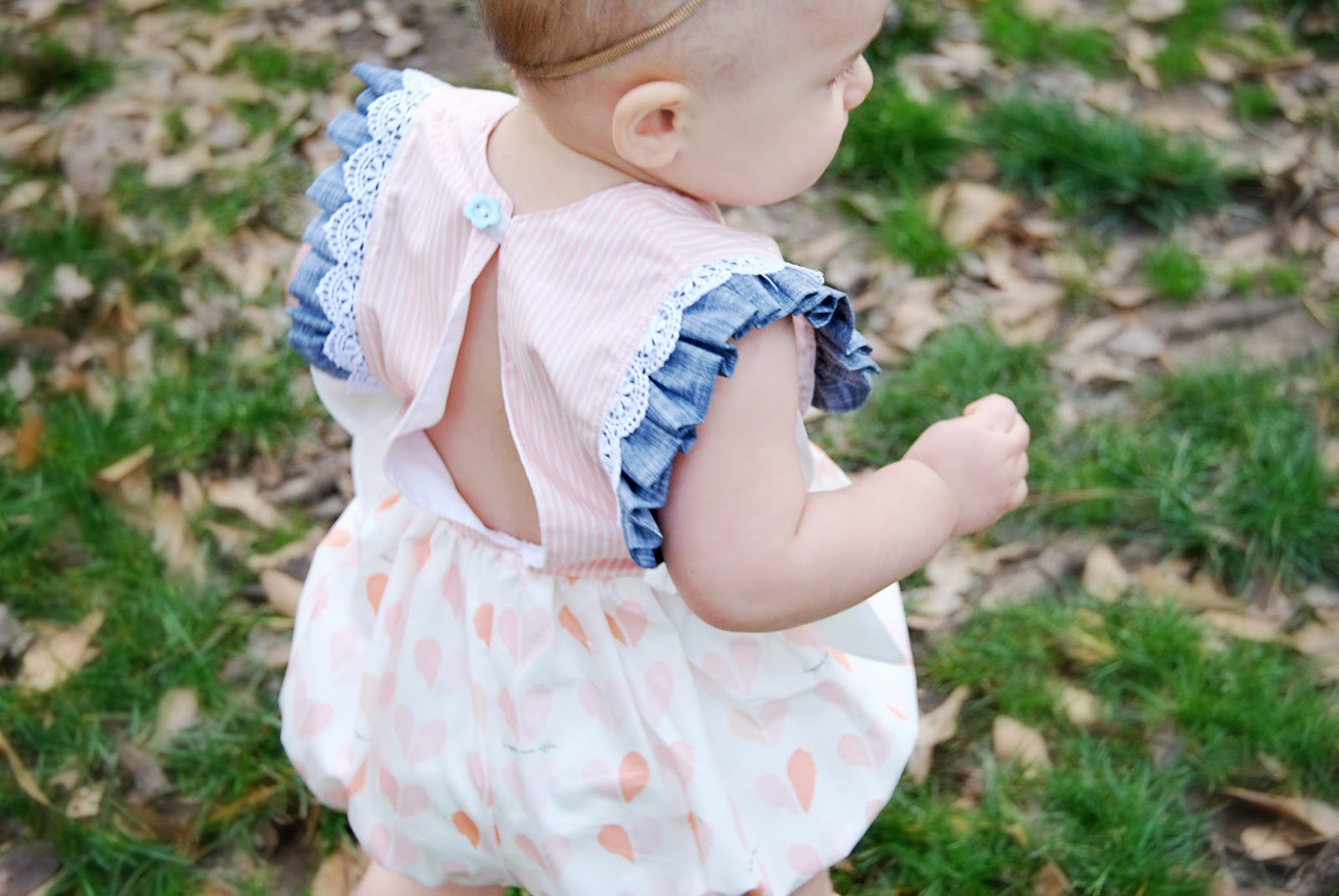 c017a06e1 The fabric is very sturdy and the attention to detail in the lace, side  bows and back cut out are incredible. The lace and chambray give the romper  a ...