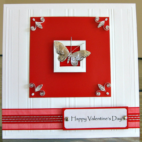 valentine with a butterfly sticker and a quilled design in each corner of the square card