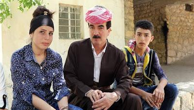 Luqman Suleiman, en el centro.