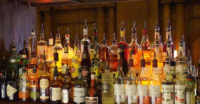 Bar stocked with bottles of spirits