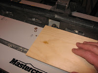 Use the router to apply a decorative edge to all 4 sides of the base