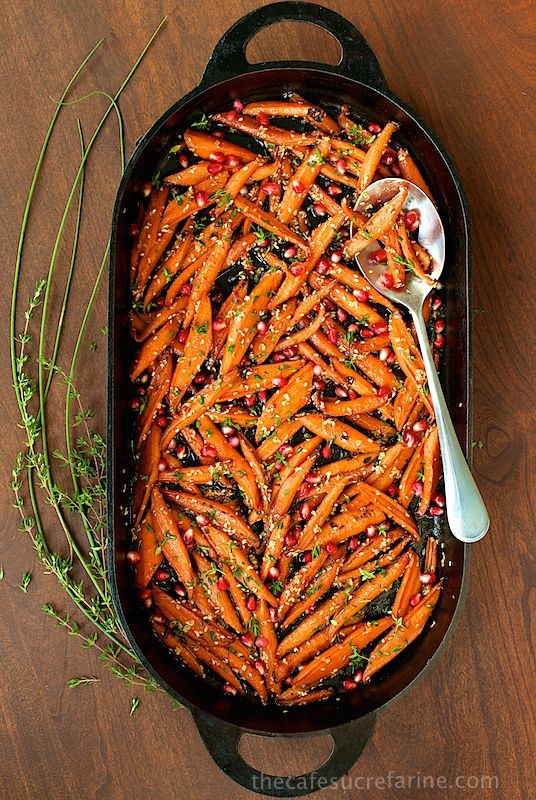 I made these last year, and they were a hit with EVERYONE. Not one carrot slice was left over. I made them the night before and heated them in the oven right before our meal. They tasted so good, and I think the second time heating them up really helped to caramelize them. You have to make them!!!