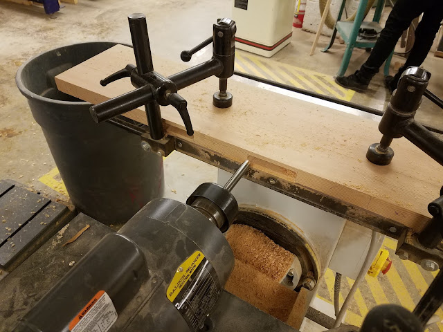 A mortising tool is effectively a drill press spindle lying flat on a table, and can cut notches into the sides of wooden planks