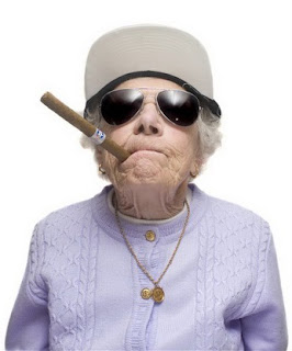 Funny crazy old woman smoking cigar image