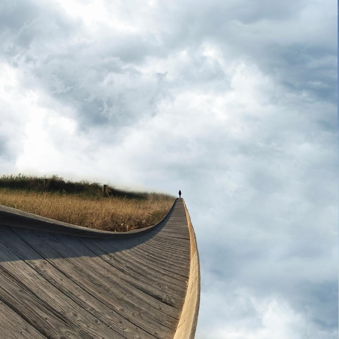 15-Walking on the edge-Laurent-Rosset-Surreal-Photo-Manipulations-of-the-World-Around-Us-www-designstack-co
