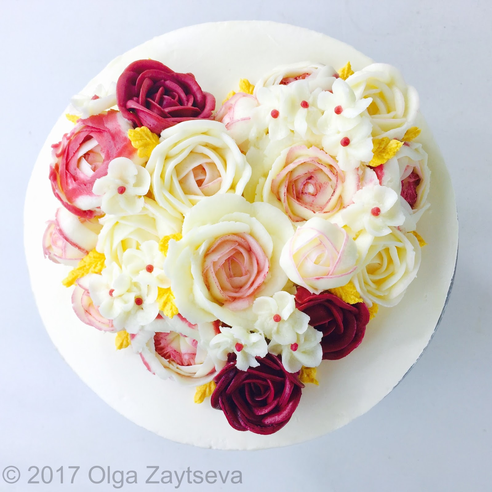 Valentines day buttercream flower cake olga zaytseva learn how to pipe variety of roses and create this heart shaped buttercream flower bouquet cake for valentines day celebration izmirmasajfo