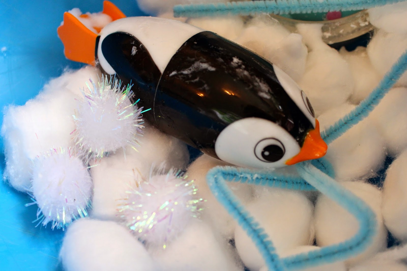 Snowy sensory play activity for toddlers and preschoolers.  Create a simple small world winter scene using foam soap, penguins and polar bears.