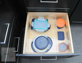 Organized drawer of left over container lids :: OrganizingMadeFun.com