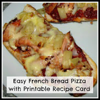 Cooked French bread pizza with ham and pineapple.