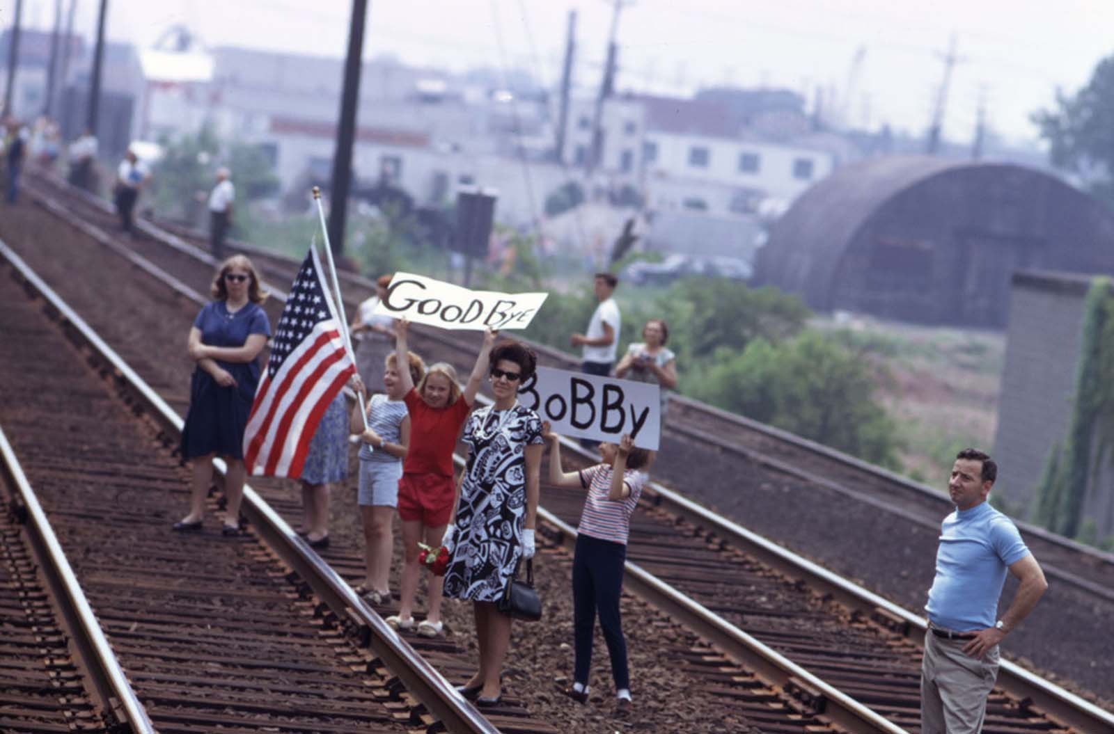 Mourners line the tracks to bid farewell to Robert F. Kennedy as his funeral train passes on its way from New York City to Washington, D.C., on June 8, 1968.