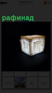 На черном фоне изображение рафинада по типу кубика рубика сложены и подсвечены из нутри