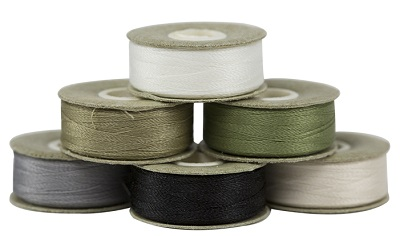 Thread package is the most common and essential garments accessories in  Popular Thread Packages Used in Apparel Industry