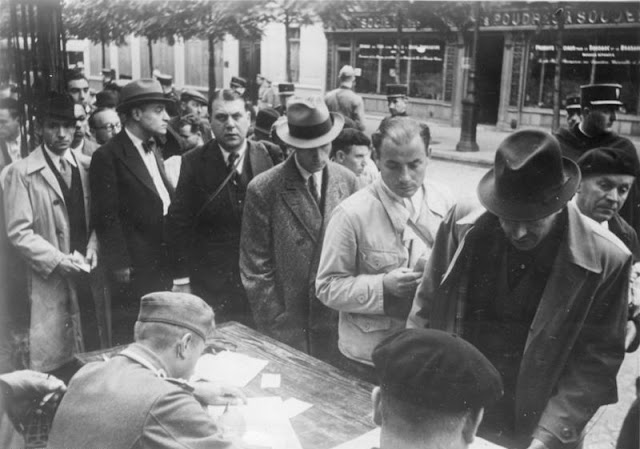 Jews who have been arrested in Paris being processed by the police, 21 August 1941 worldwartwo.filminspector.com