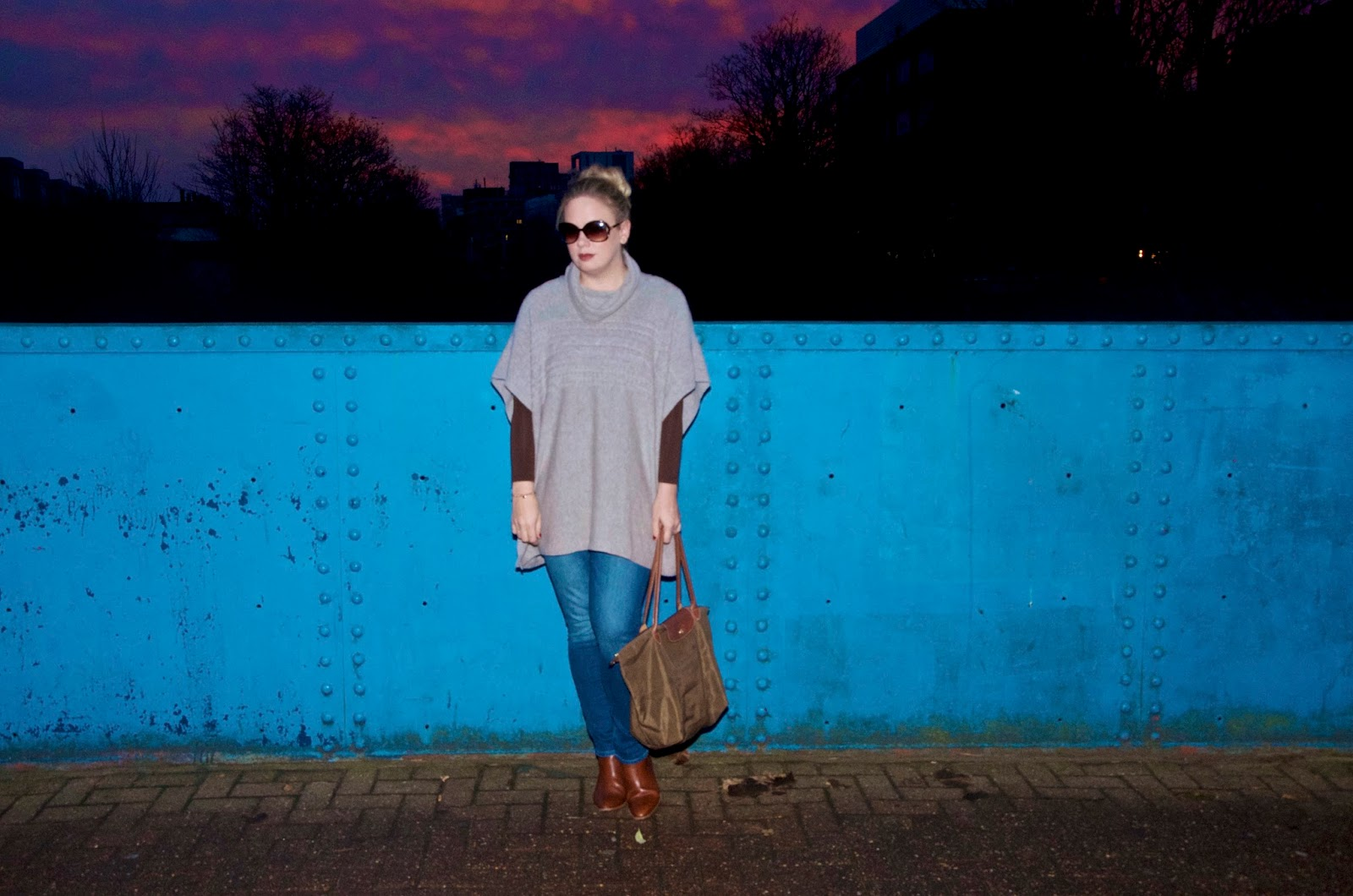 Pink Skies, blue bridge, taupe poncho, green bag and jeans