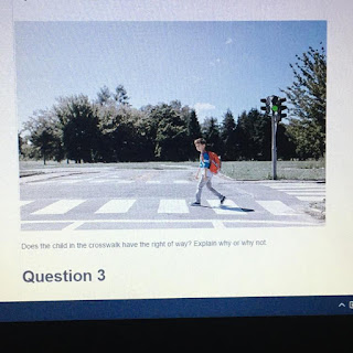 Does the child in the crosswalk have the right of way? Explain why or why not