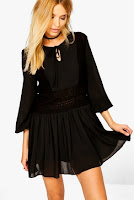 http://www.boohoo.com/victoria-volumised-sleeve-lace-skater-dress/DZZ72699.html?color=105