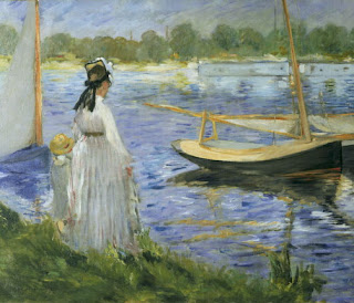 A mother with her child is standing on the river bank and looking at the moving river