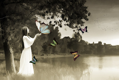 artistic-y pic of girl in washed out colours with large, vibrant butterflies around her