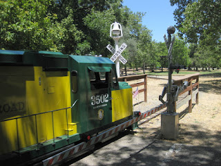 Diesel locomotive 3502, Billy Jones Wildcat Railroad, at a train crossing, Oak Meadow Park, Los Gatos, California