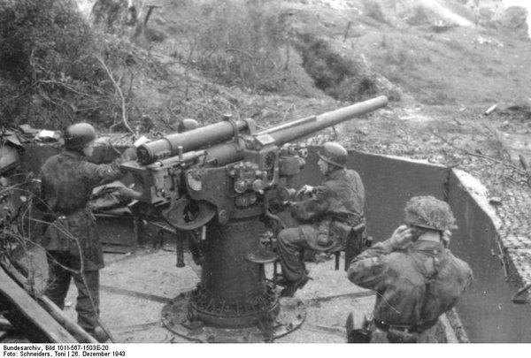 German paratroopers manning a 7.5 cm Flak 264/3(i) anti-aircraft gun, San Felice Circeo, Italy, December, 1943.