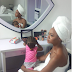 Bread Seller Turned Model, Olajumoke Beautiful in A towel-clad As She poses with her daughter