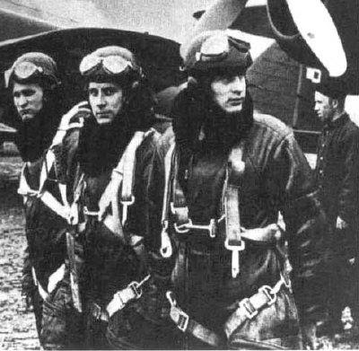 WW2 Polish Pilots (background is famous the PZL 37 Los Polish bomber )
