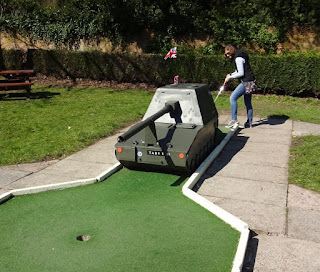Emily playing the Crazy Golf course at Haigh Woodland Park