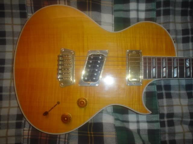 it's maple-capped, single cut-a-way mahogany body, along with its mahogany  neck, white binding and traditional headstock are reminiscent of gibson's  les