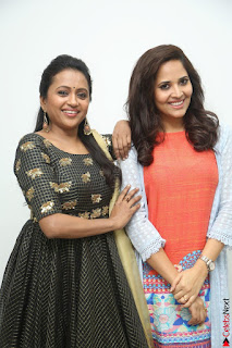 Actress Suma in Black Salwar Suit and Anusuya in orange Dress at winner movie press meet part 1 February 2017 (39).JPG