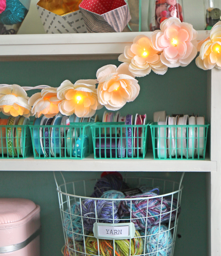 Learn to make a pretty garland using silk flowers and white Christmas lights.