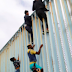 Migrants From Central American Caravan Caught Scaling The Border Fences