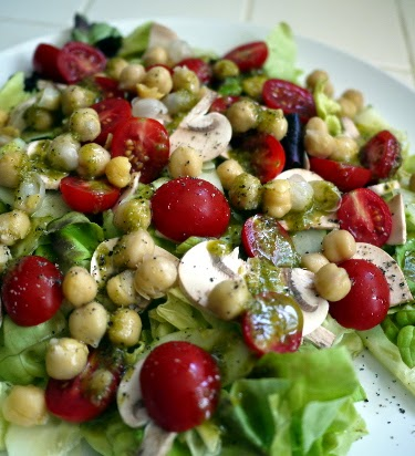 big green salad with chickpeas grape tomatoes cucumber mushroom and herb vinaigrette