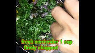 image of adding fresh coriander in khichdi