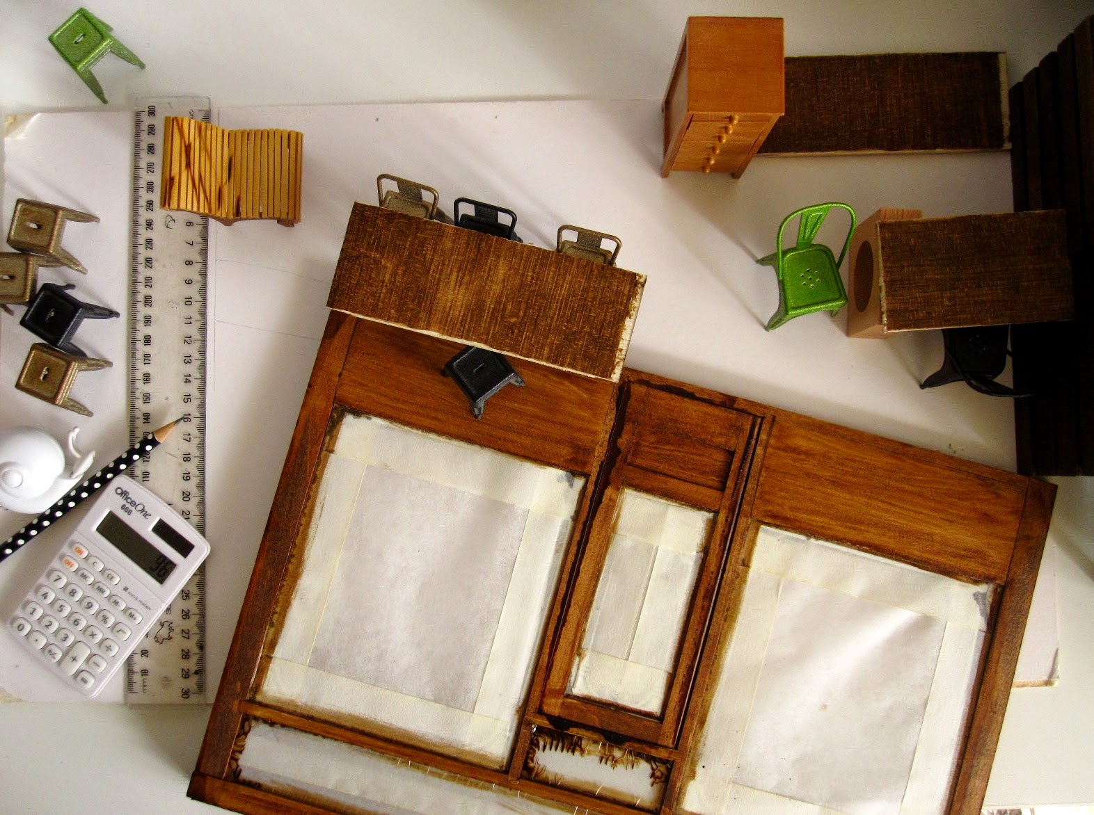 View of a modern dolls' house miniature cafe in progress, from the top.