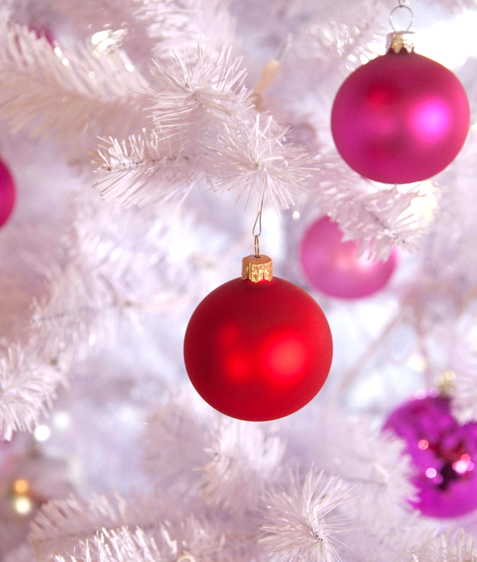 White Christmas Tree with Red and Pink Ornaments (via HGTV)