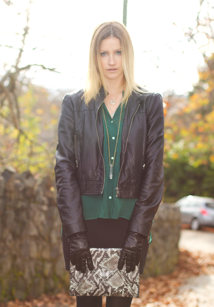 Vancouver Fashion Blogger, Alison Hutchinson, wearing Forever 21 pleather jacket, Zara forest green top, True Worth Design crystal pendant necklace, Urban Outfitters black bodycon skirt, H&M snakeskin envelope clutch, Zara black suede booties, Danier black leather gloves