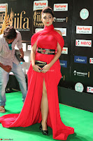 Apoorva in a Stunning Tight Leg Split Sleeveless Red Gown at IIFA Utsavam Awards 78.JPG