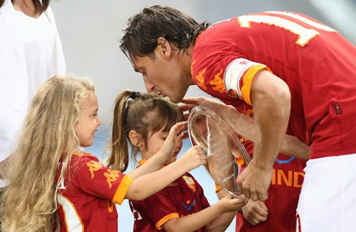 Francesco Totti and his children hold a trophy for his 206 goals for AS Roma