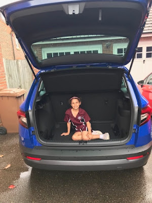 Child in the boot of a Skoda Karoq