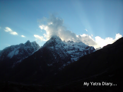 Snow clad mountainous peaks and clouds in the Mana Village near Badrinath in the Garhwal Himalayas in Uttarakhand