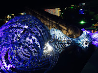 Bristol Whales sculpture lit at night - made out of plastic bottle refuse