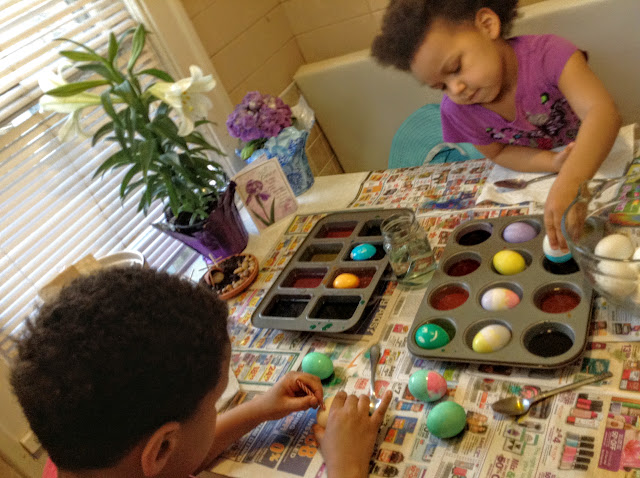 Kids hard at work on Easter eggs